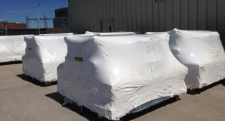 Equipment item wrapped for rail transport